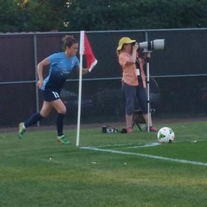 Kelley O'hara corner kick